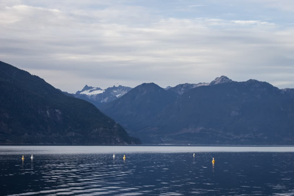 Porteau Cove is a lake surrounded by mountains in Vancouver, Canada