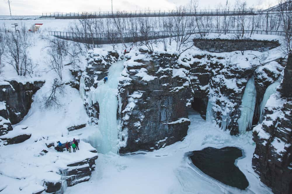 Frozen Waterfalls and a snowy landscape in Abisko, Sweden in January