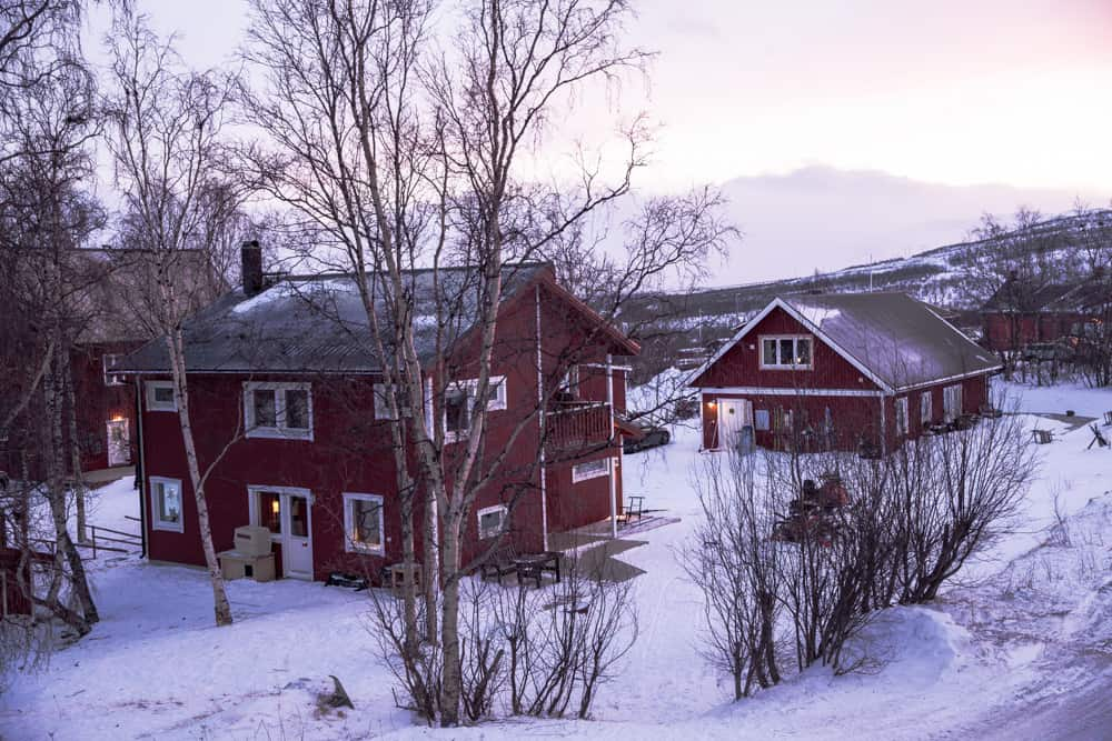 Red Buildings surrounded by snow in Abisko, Sweden in January