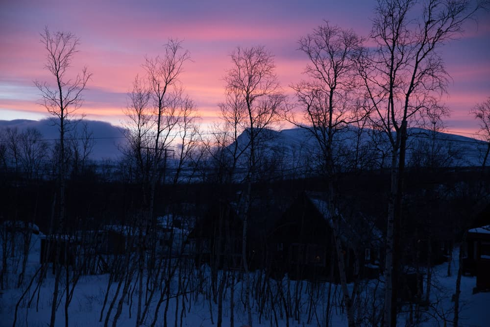 Pink sunset in Abisko, Sweden on a winter day in January