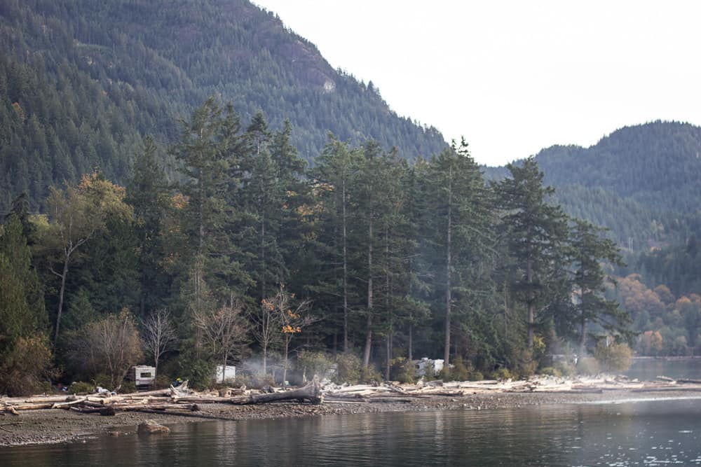 Porteau Cove is a lake surrounded by trees and mountains near Vancouver, Canada, BC