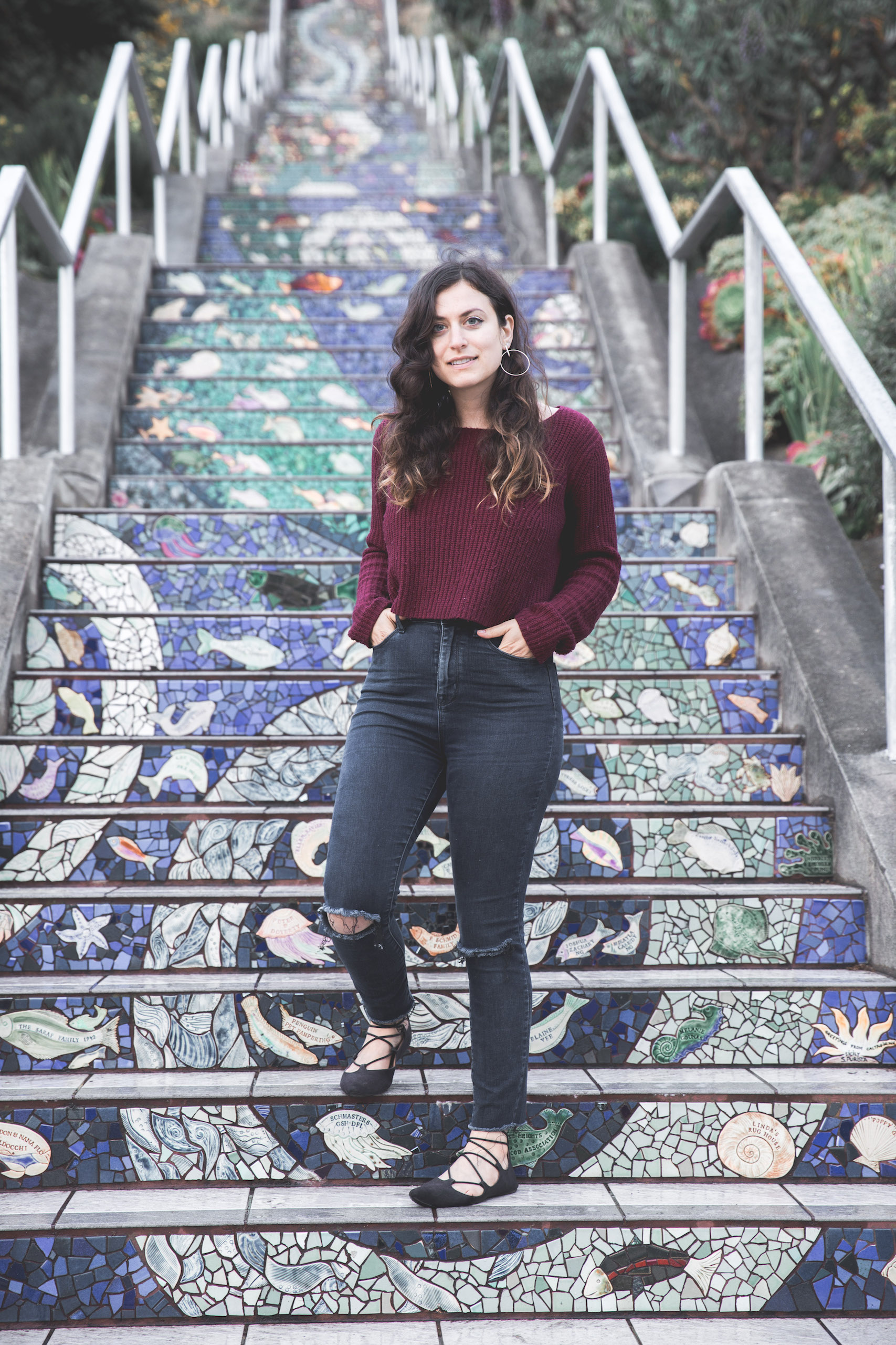 Kelsey standing on the 16th Avenue Tiled Steps in the San Francisco Bay Area