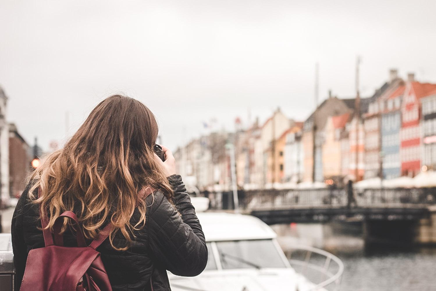 Taking photos in Nyhavn, Copenhagen