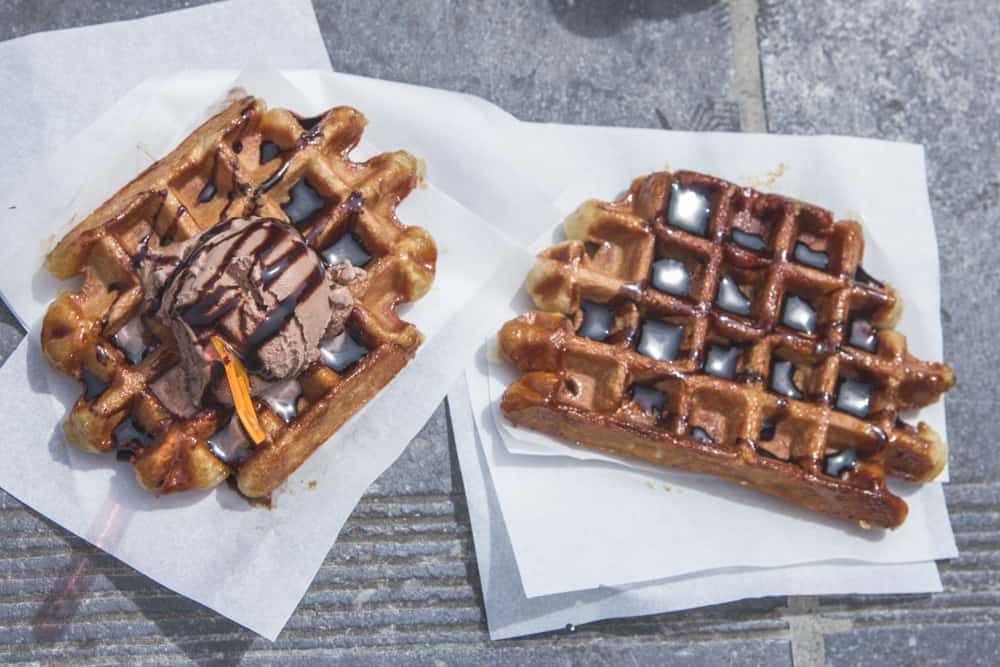 Belgian Waffles topped with ice cream and chocolate sauce in Brussels, Belgium outside Monte des Artes