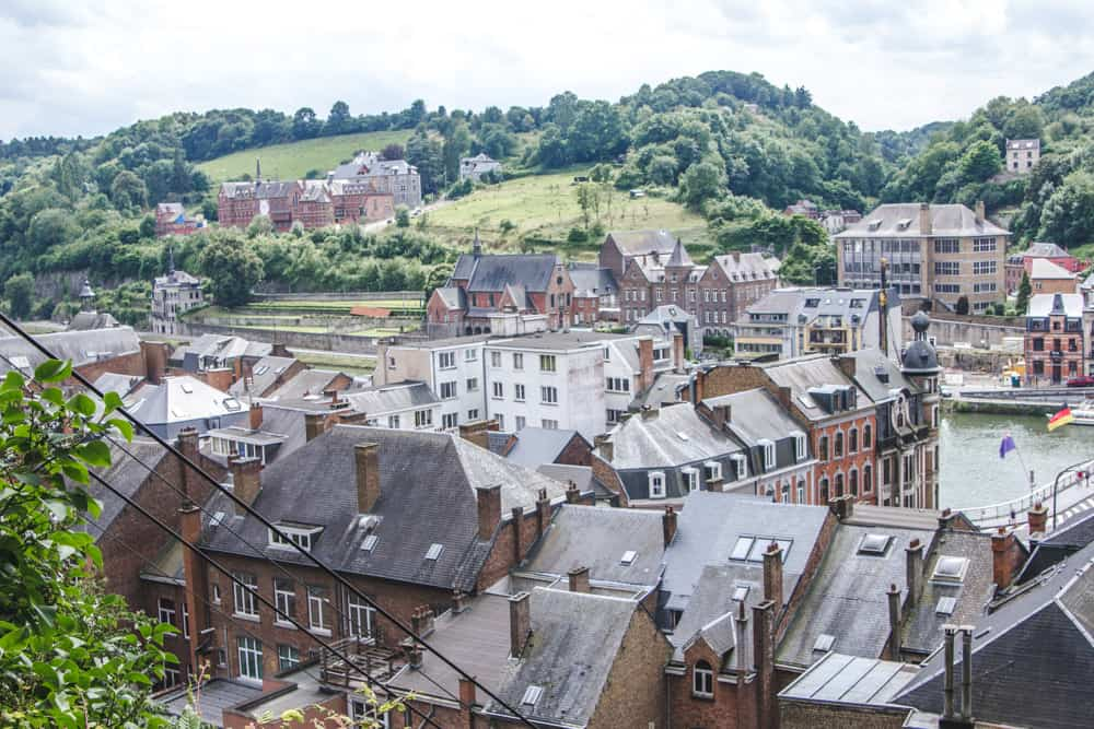 View of rooftops and rolling green hills from the citadel in Dinant, Belgium