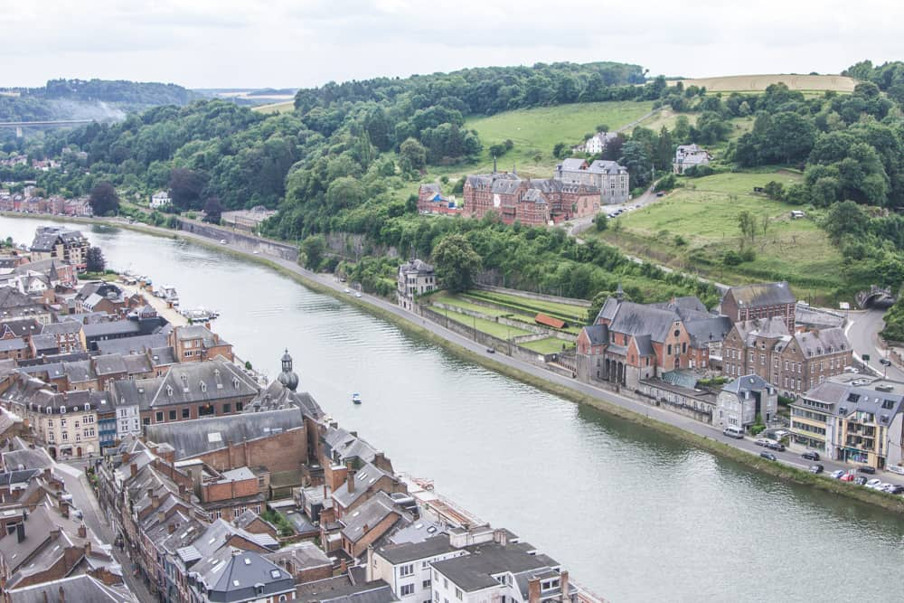 View from the Citadelle de Dinant, or Citadel of Dinant, of buildings along the river in Dinant, Belgium