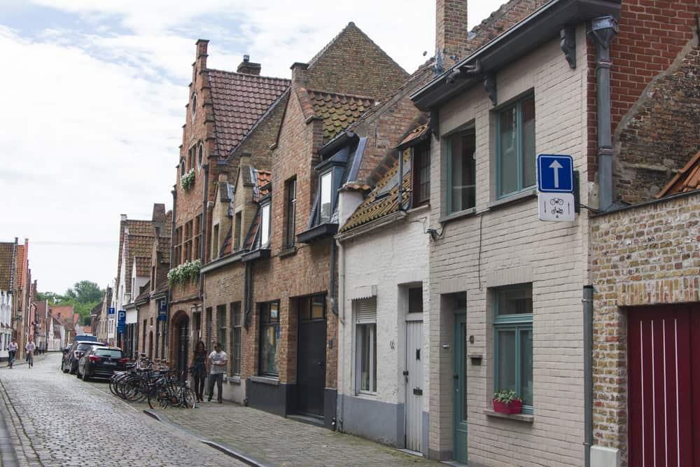Brick buildings in Bruges, Belgium on cobblestone streets