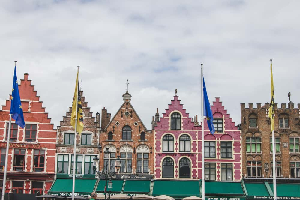 The main square in Bruges, Belgium has pretty brick and colorful buildings