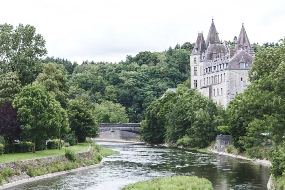 Durbuy Castle in Belgium on the river surrounded by trees