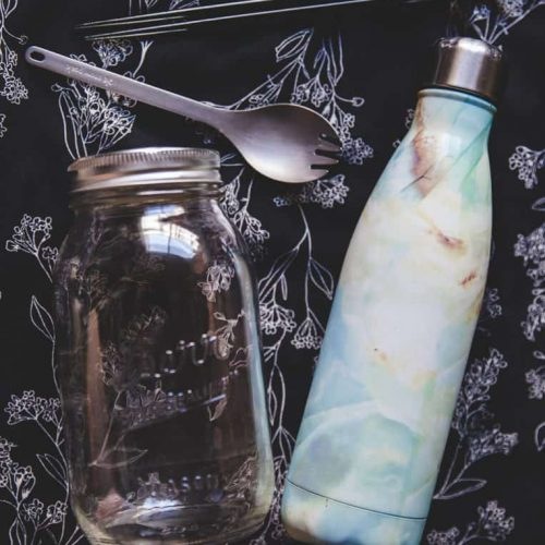 A reusable water bottle, spork, and mason jar