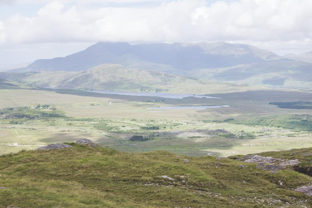 View of green hills and mountains in Connemara National Park in Ireland