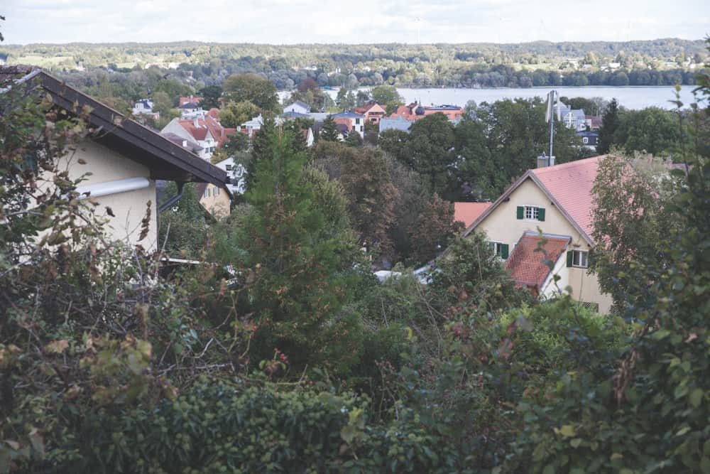 View of trees, rooftops, and the lake from St. Joseph's Church in Starnberg, Germany in September