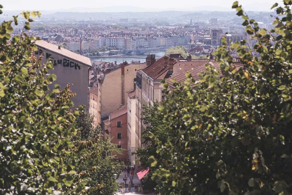 View of pretty pastel buildings from the top of the Mont Croisse Hill on La Montée de la Grande Côte in Lyon, France.