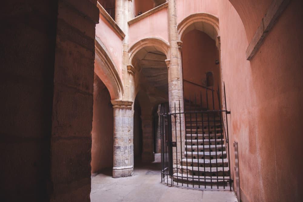 Inside a pastel peach traboule in Vieux (Old) Lyon