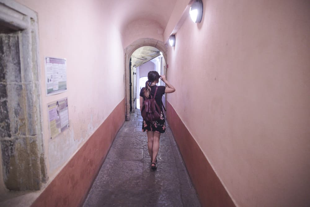 Girl walking in a traboule in Old (Vieux) Lyon