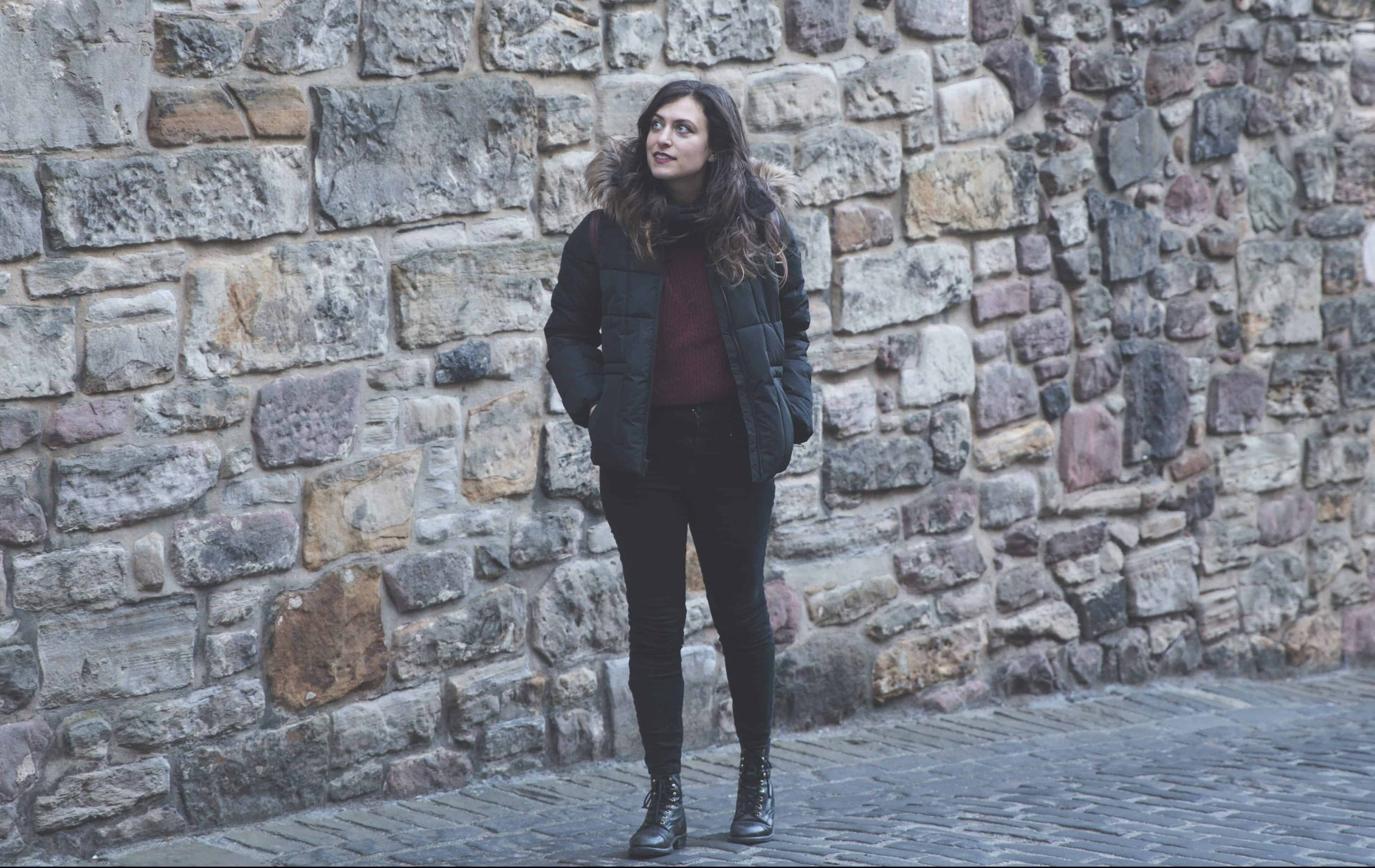Kelsey walking through Edinburgh wearing items she packed for 3 months in Europe during winter!