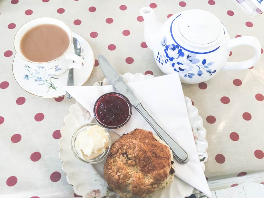 Cream Tea in England consists of tea, clotted cream, jam, and a fruit scone