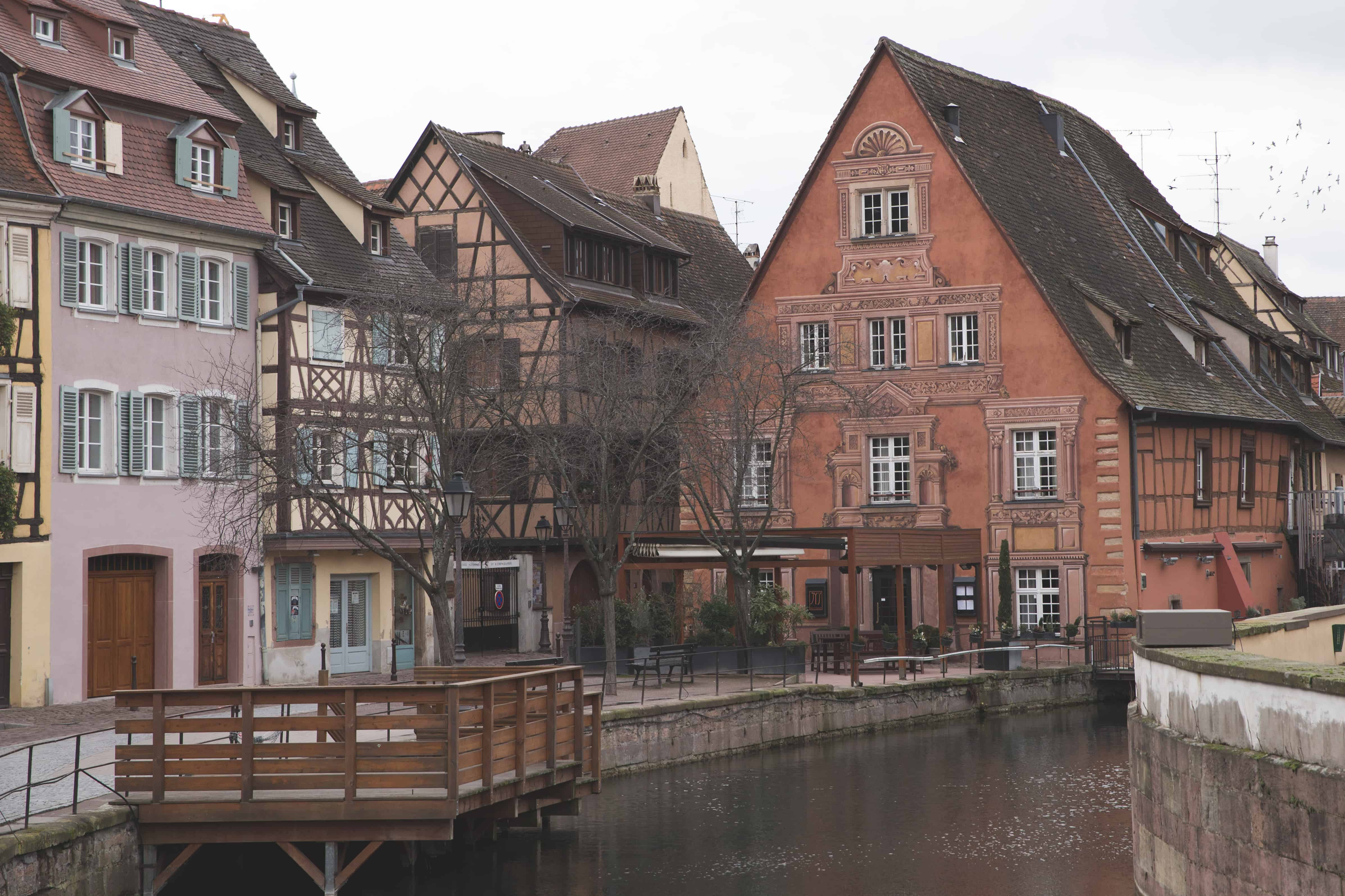The canals of Colmar along the La Lauch are beautiful next to the colorful, half-timbered buildings and houses