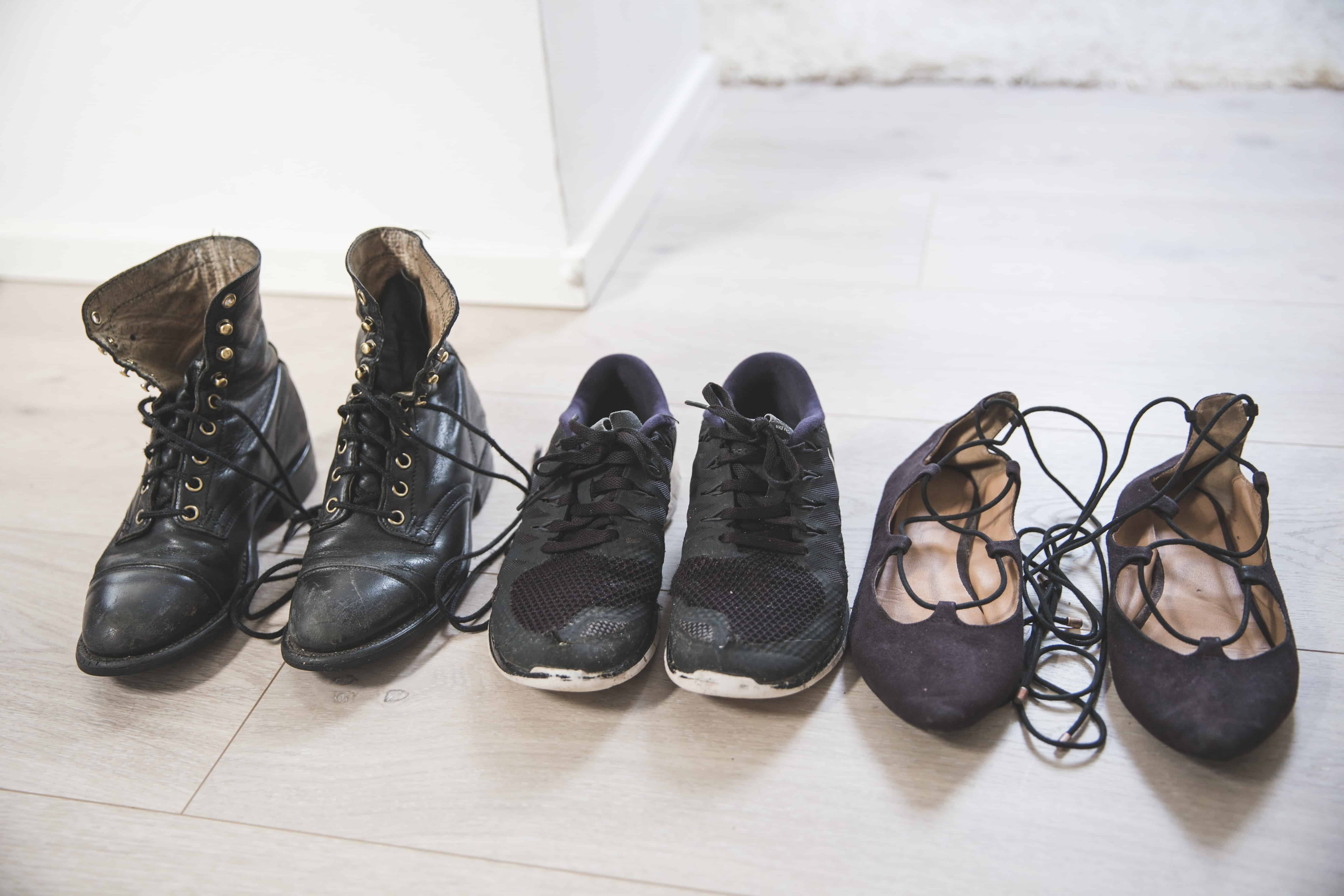 The three pairs of shoes that I brought for winter in Europe: lace up black waterproof boots, black Nike sneakers, and lace up black flats