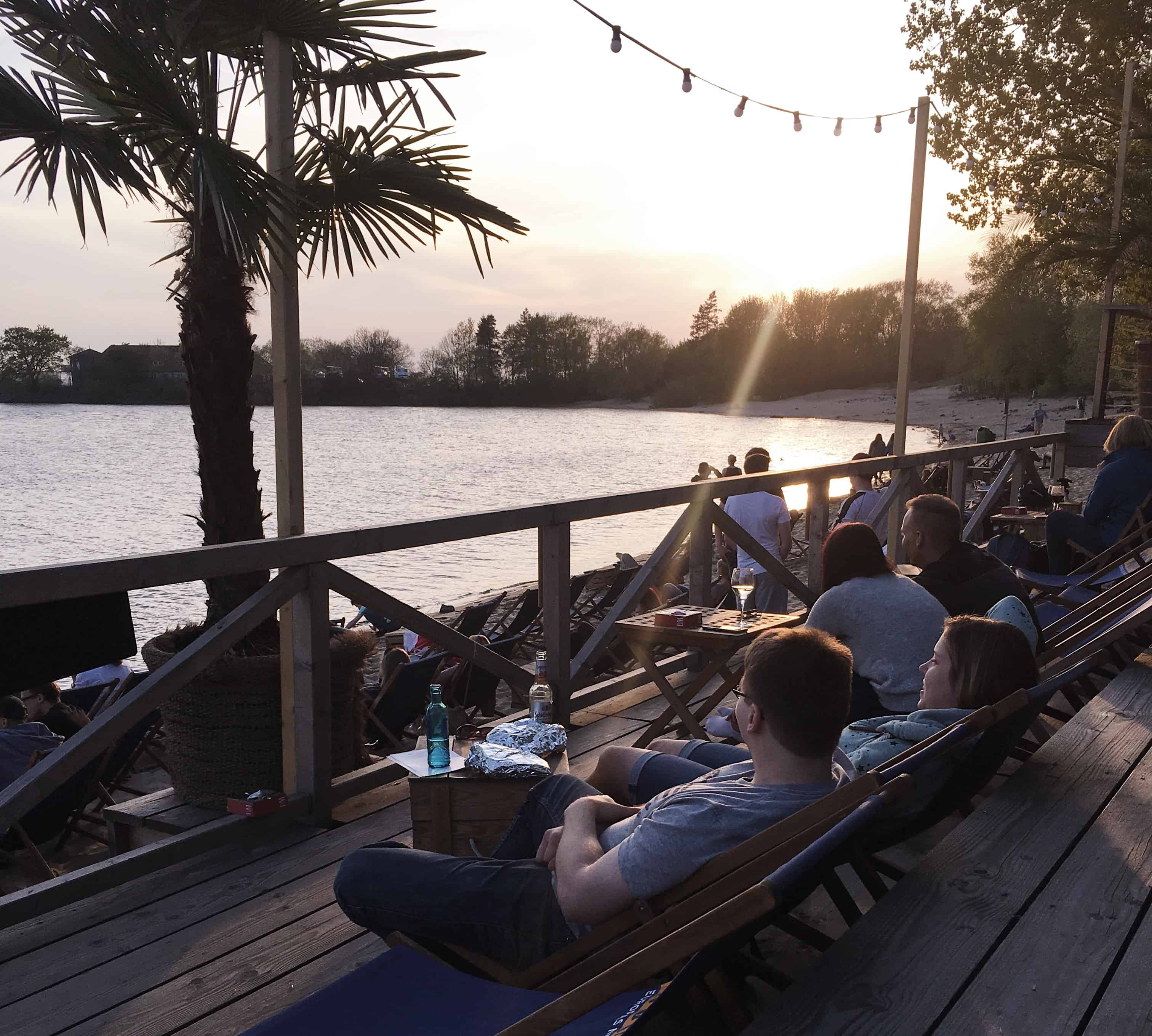 A beach bar in Hamburg, Germany at sunset