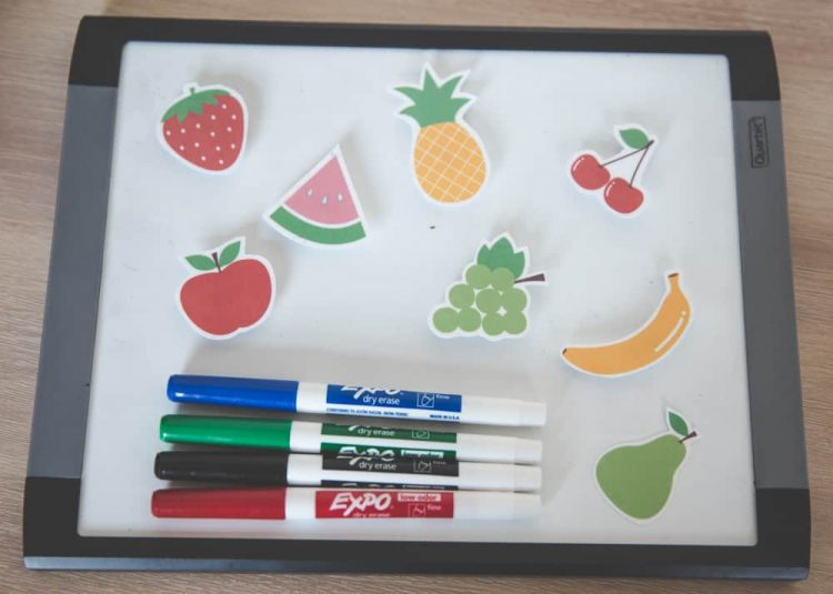 whiteboard with whiteboard markers and pictures of fruit - essential props for vip kid teachers!