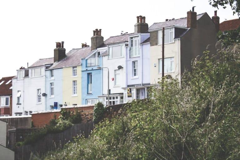 Colorful pastel houses in Scarborough, England - one of the Yorkshire coastal towns to visit