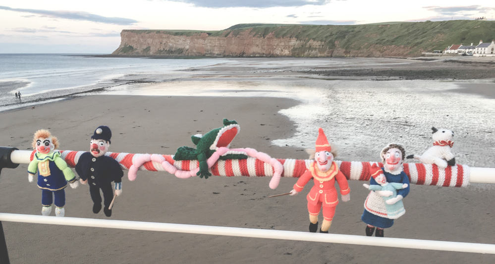 Knitted dolls along the Saltburn Pier