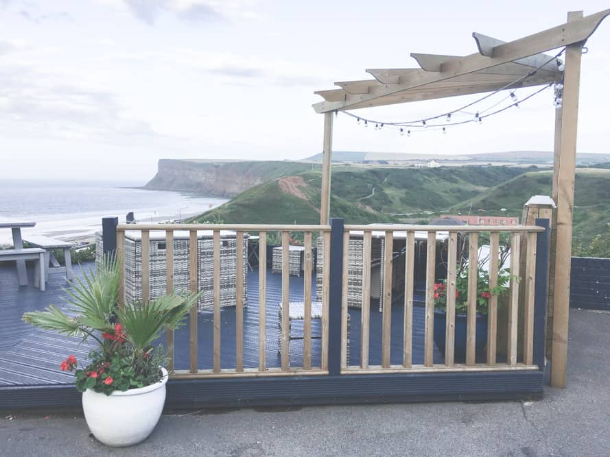 The outdoor seating at The Spa Hotel in Saltburn-by-the-Sea, England has a beautiful view
