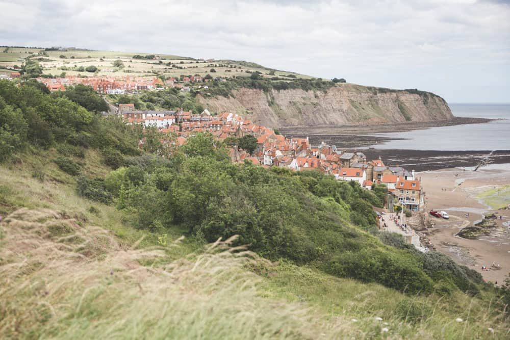 View of Robin Hood's Bay and its red orange tile roofs - an iconic Yorkshire coastal town to visit in England