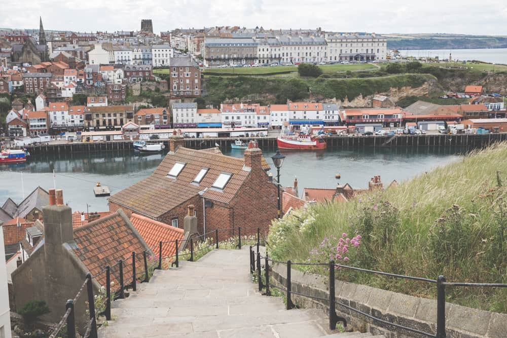 The view of Whitby, one of the Yorkshire coastal towns in England, from the 199 steps up to the Whitby Abbey