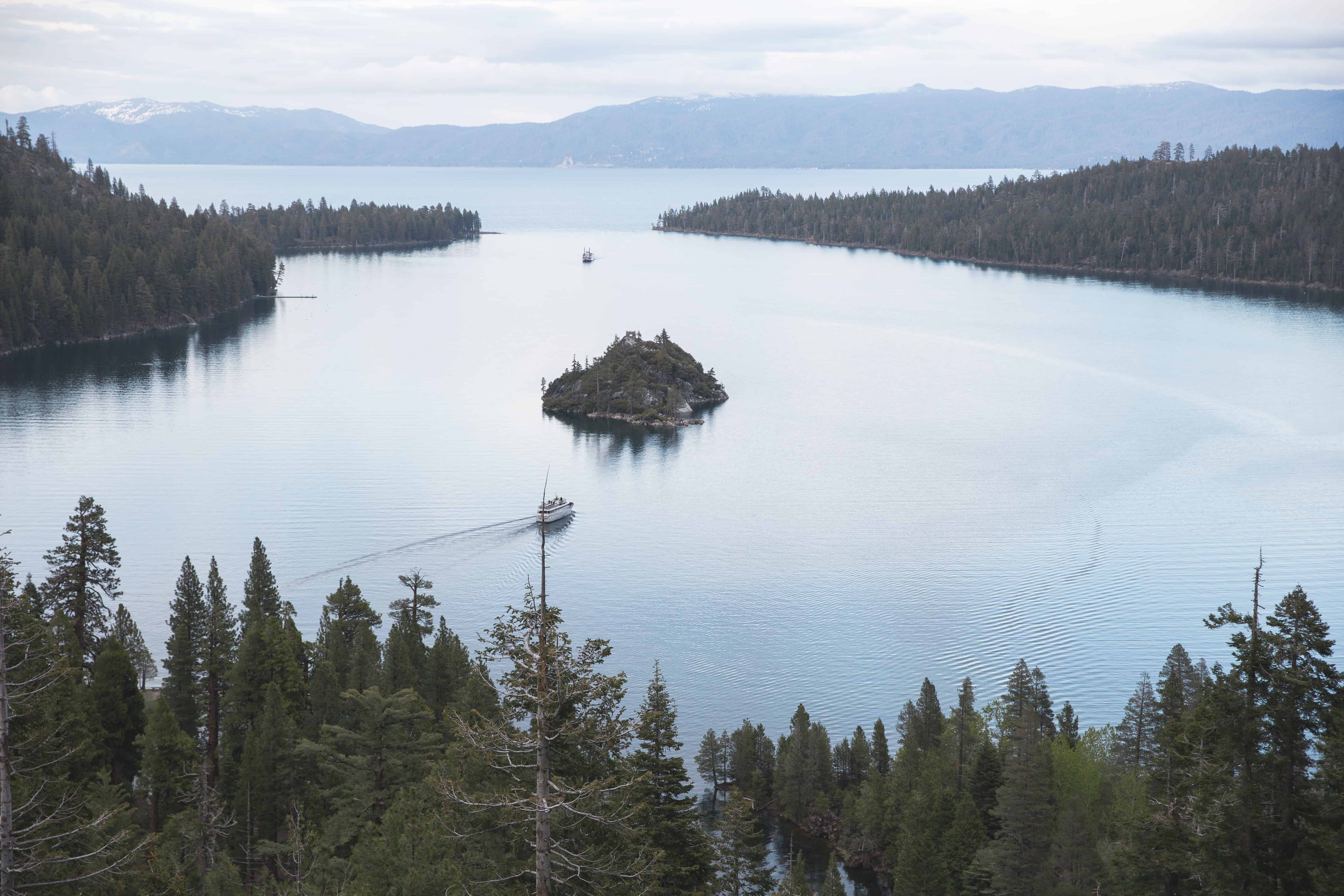 The Emerald Bay overlook in Lake Tahoe, California is full of pine trees, the lake, and mountains!