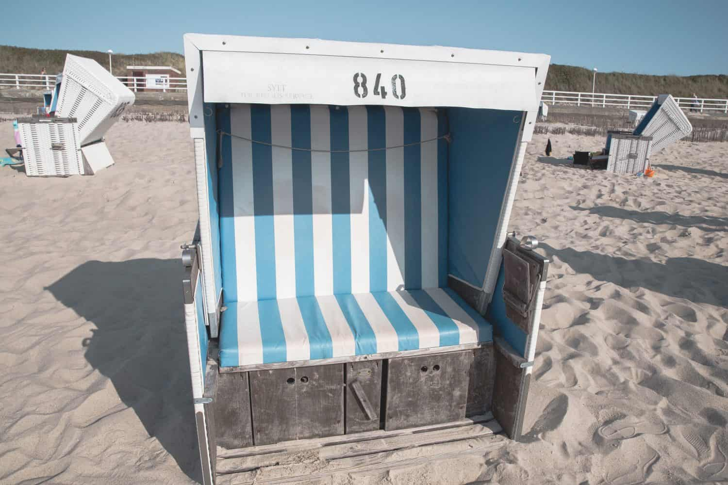 A strandkorb, or fancy beach chair, on one of the beaches in Sylt, Germany.