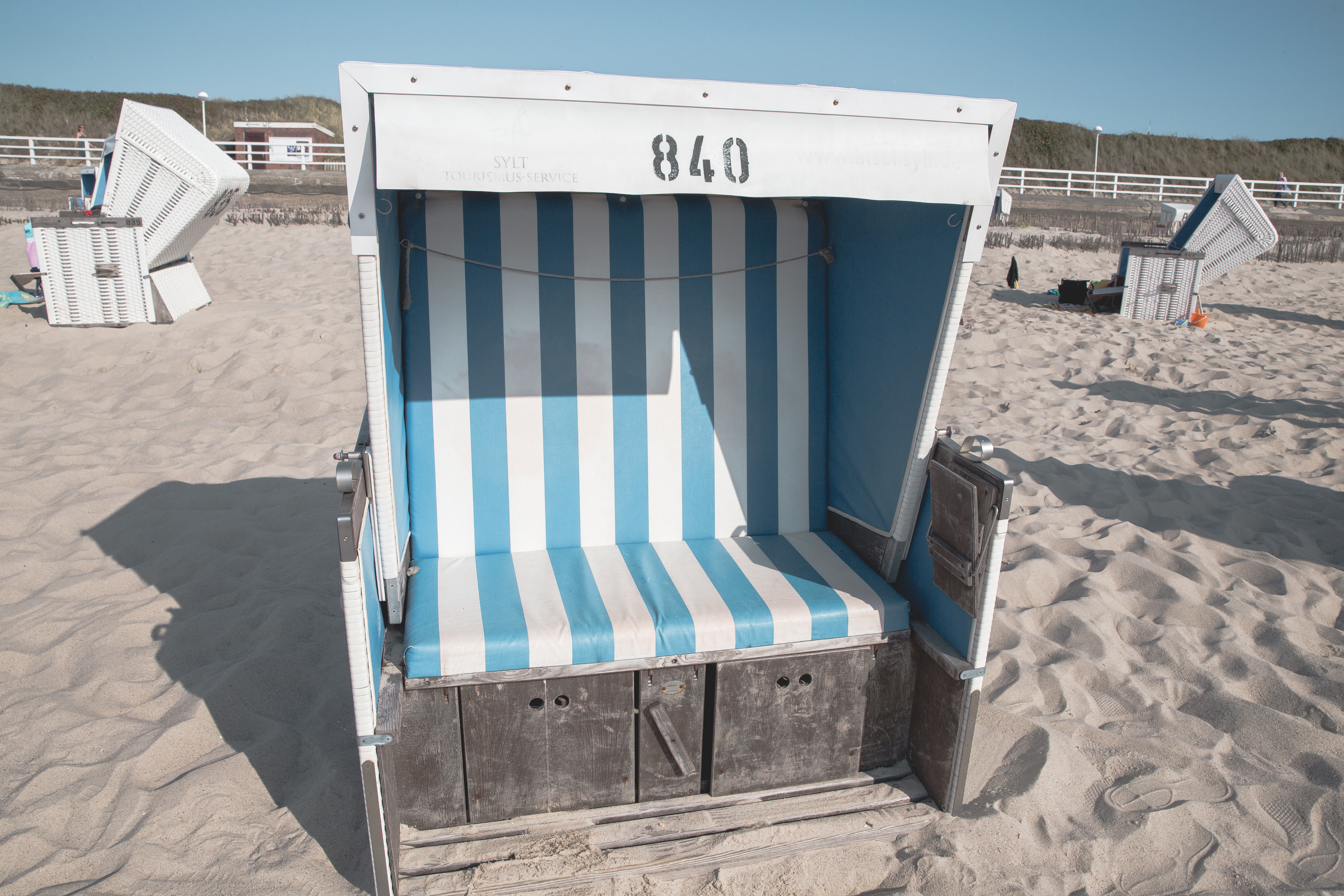 White beach chair, or strandkorb, on the beach on Sylt, an island in northern Germany