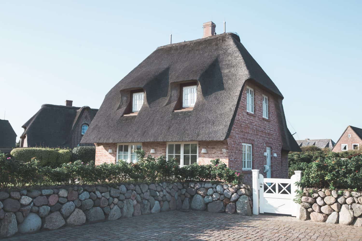 Traditional brick and thatched roof house in Sylt, Germany