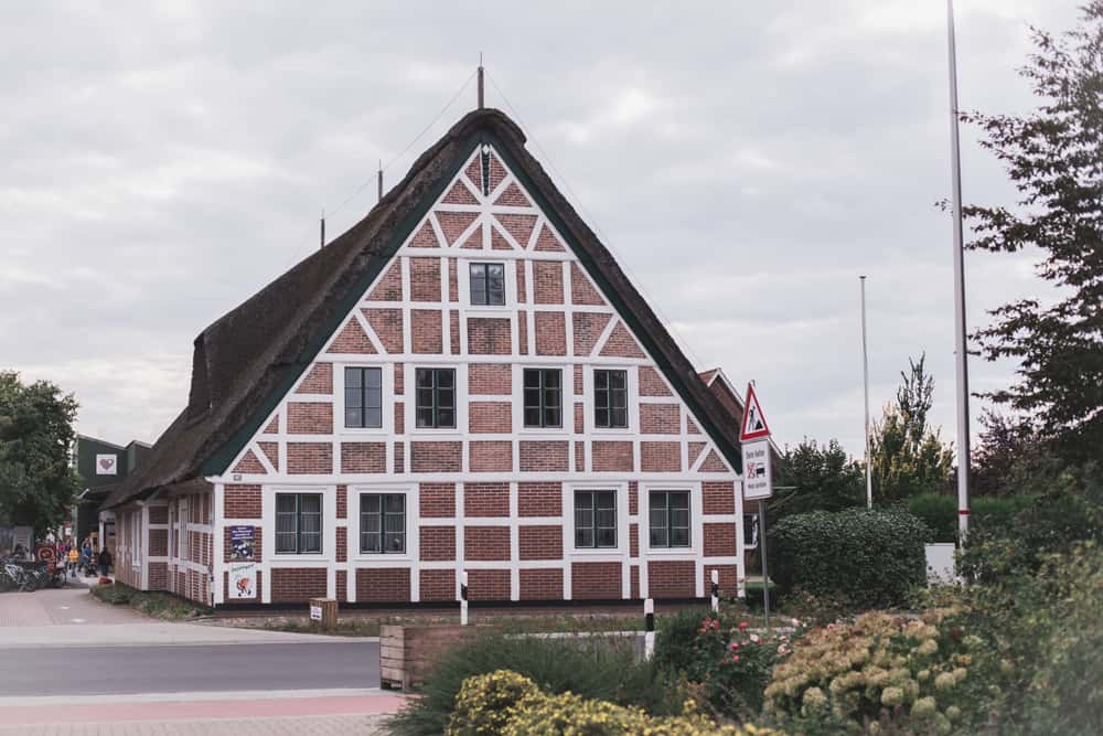 Traditional half timbered and thatched roof house or building in Altes Land, Germany