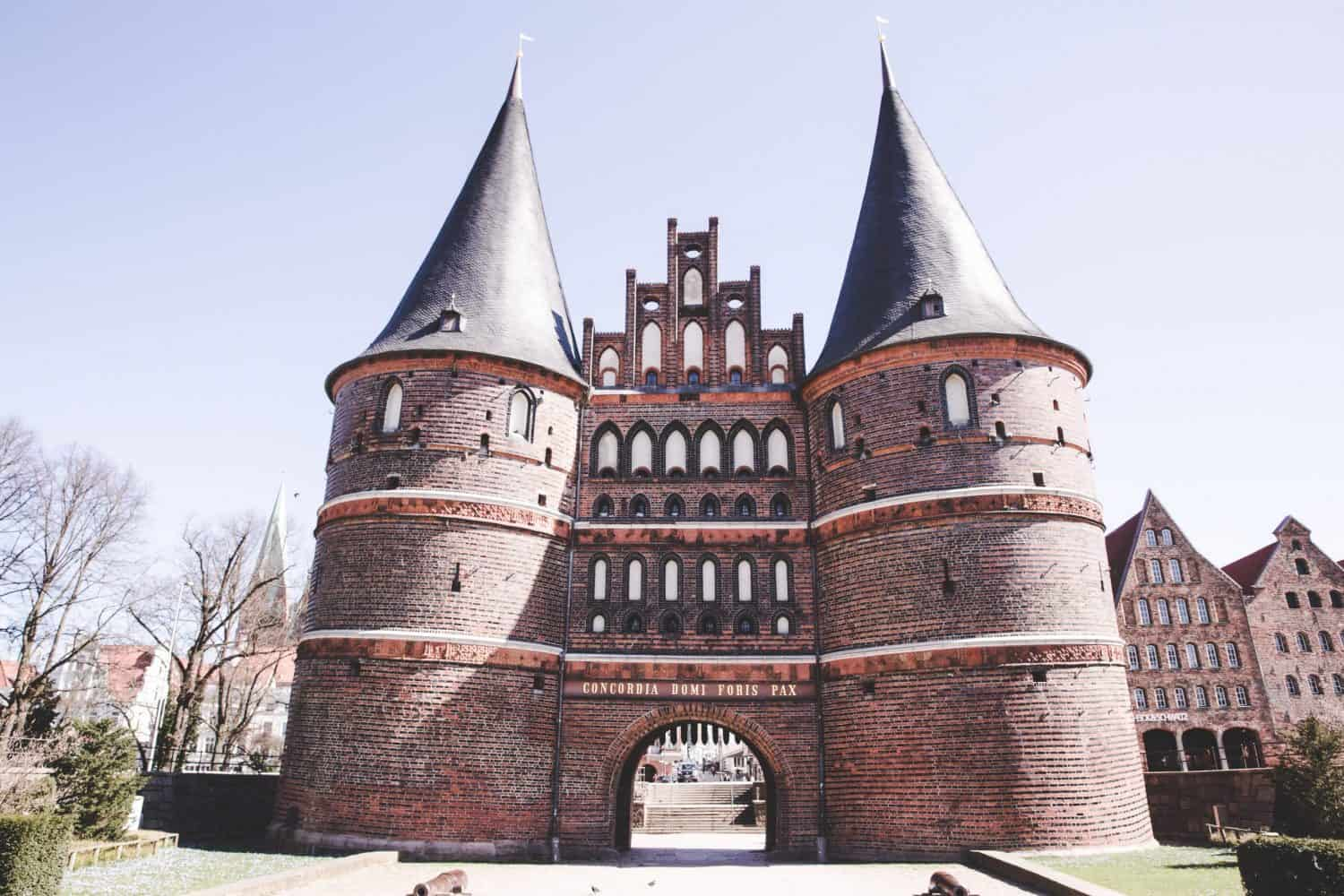 Holstentor is the old city gate made of Brick Gothic architecture. Lübeck is one of the best day trips from Hamburg!