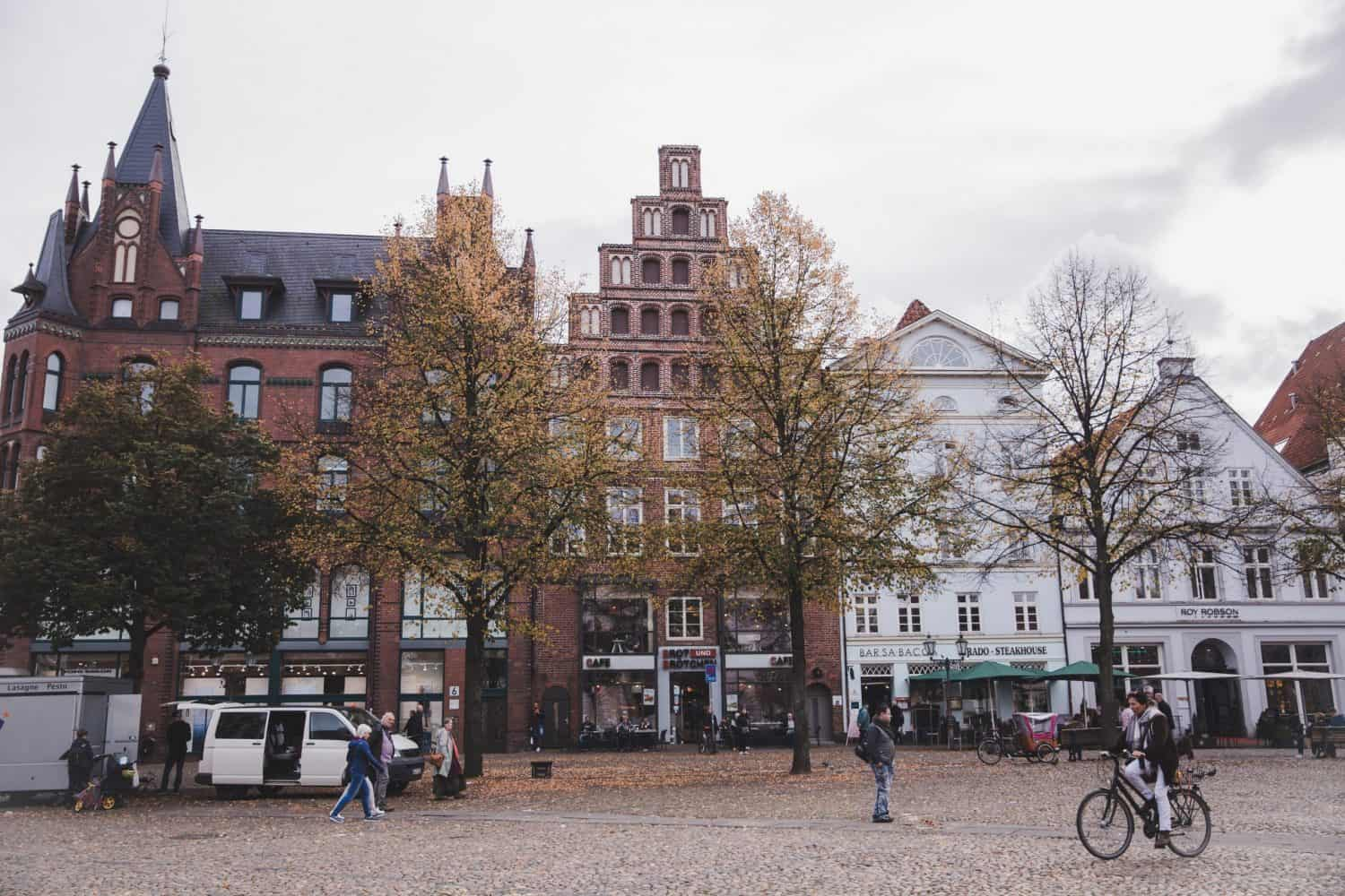 Looking for day trips from Hamburg? Lüneburg is a great town located only 45 minutes away by train.The Lüneburg main square, pictured here, is lined with pretty brick buildings and a great place for shopping and walking around.