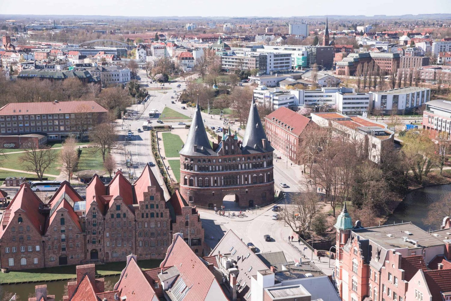 View of Holstentor, Lübeck's city gate, from St. Peter's Church. Lübeck is one of the best day trips from Hamburg!