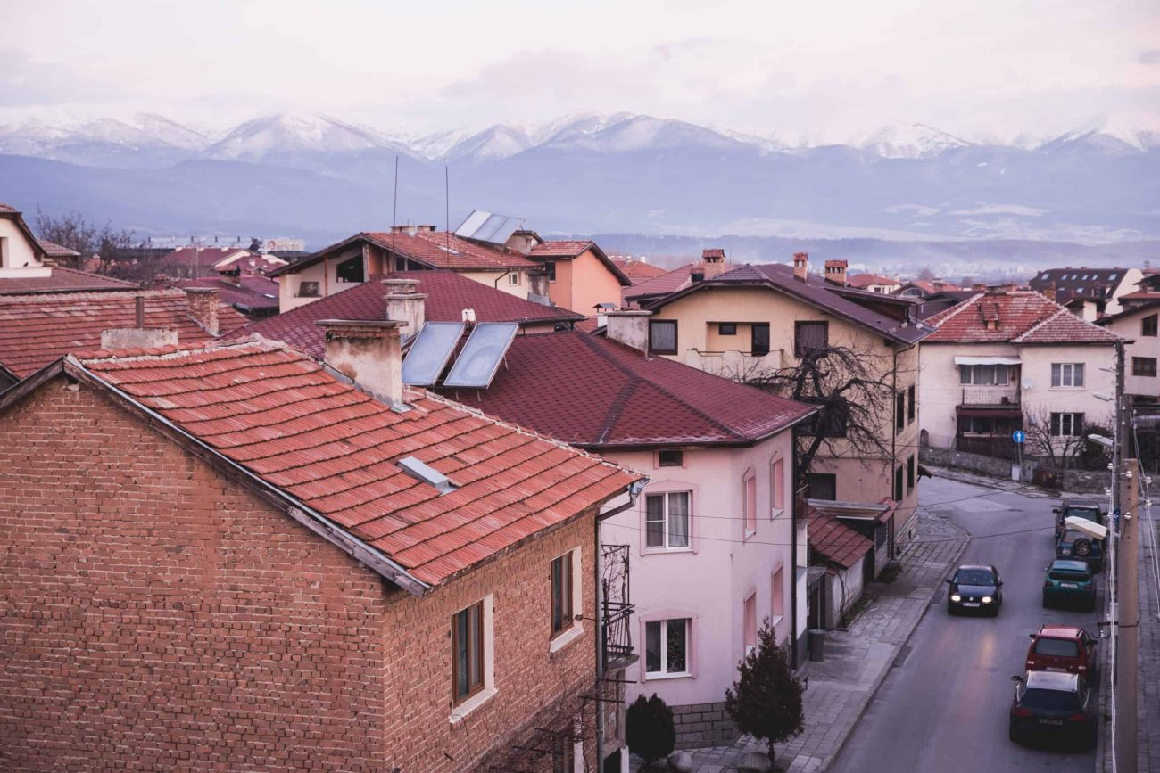 View of the mountain, houses, and street in the Bansko Old Town area in Bulgaria
