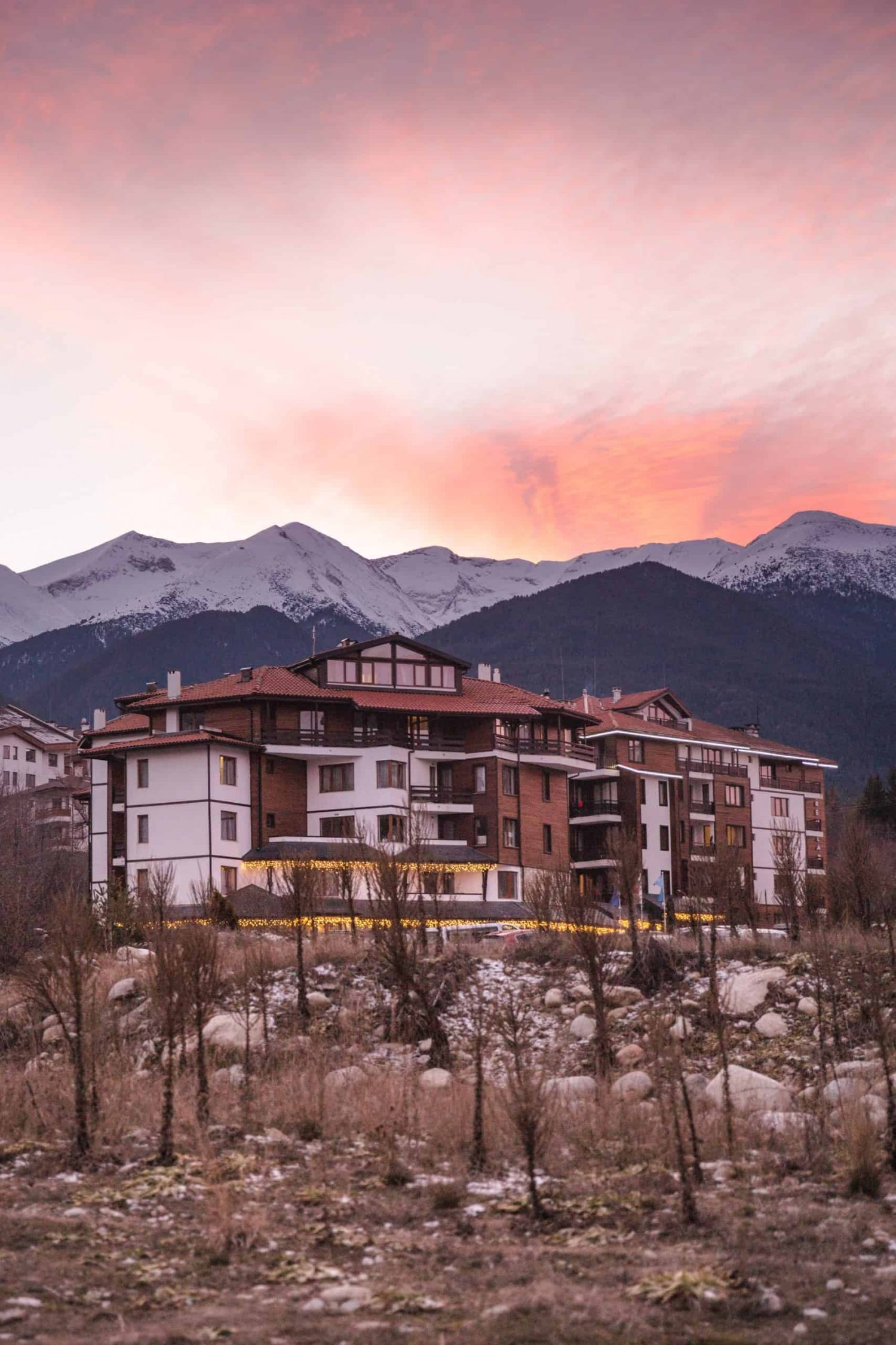 Bansko, Bulgaria at sunset. Bansko is a great adventure destination with mountains and nature, and a great place to visit in 2020!