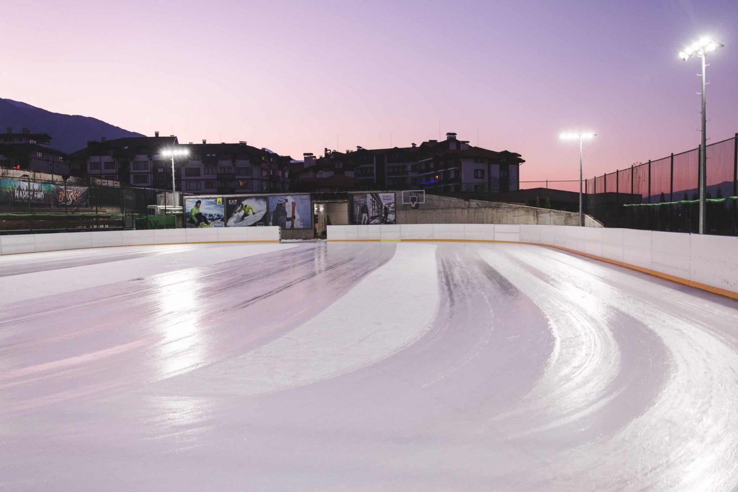 The ice skating rink in Bansko, Bulgaria at sunset.