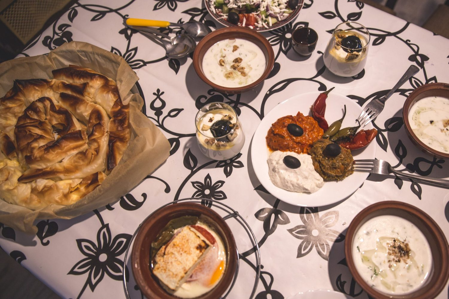 Traditional Bulgarian food, including banitsa, tarator, shopski cheese, and shopska salad!