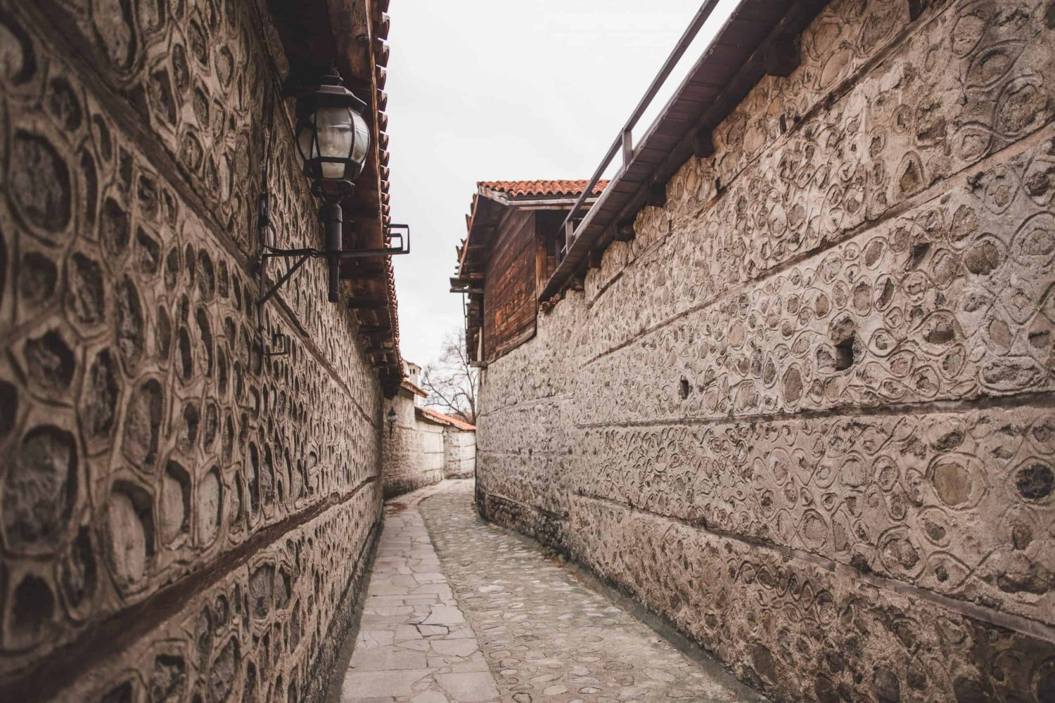 Cobblestone streets and stone walls in Bansko, Bulgaria's Old Town.