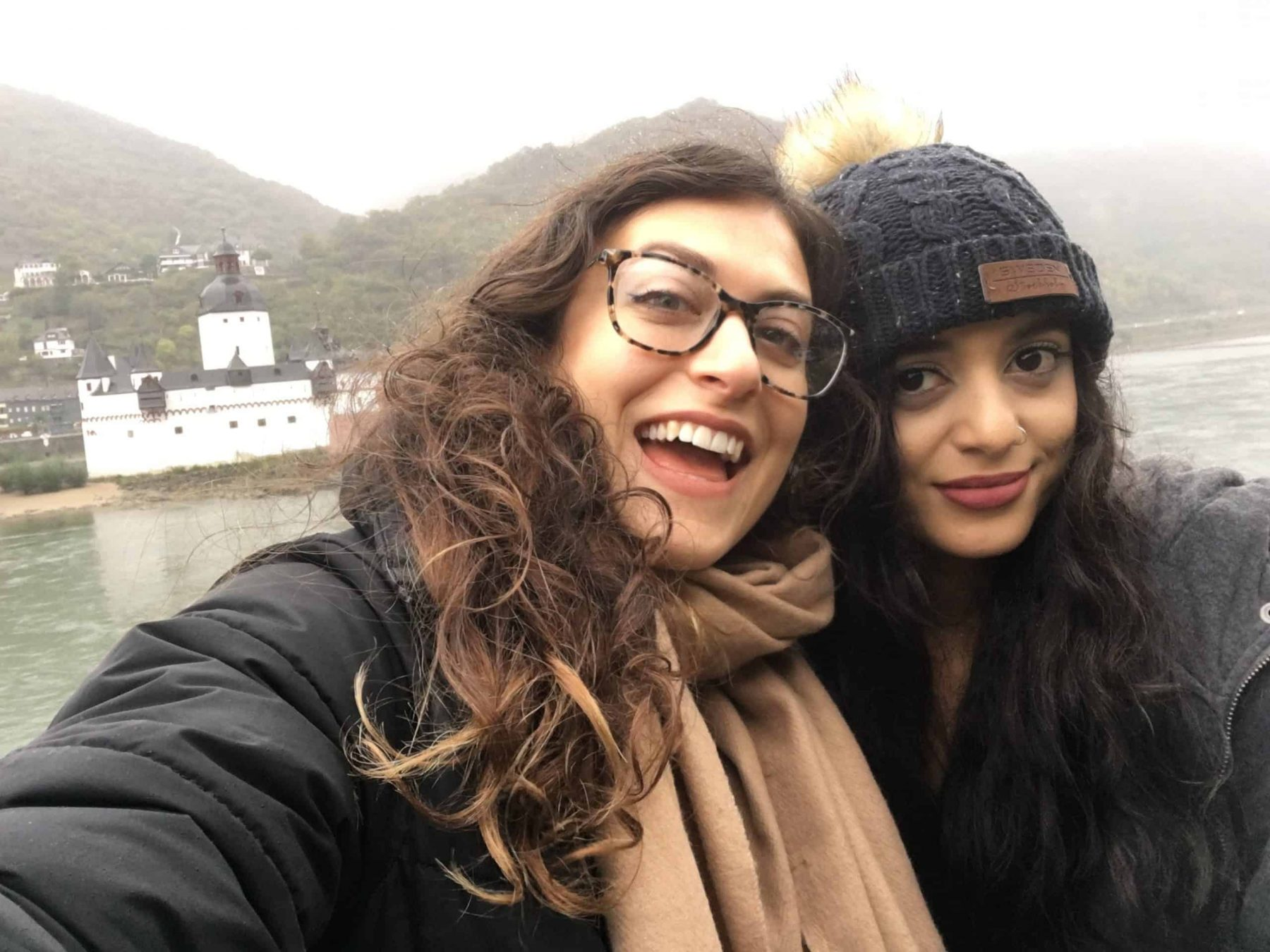 2 girls in front of a castle in Germany on the Rhine River