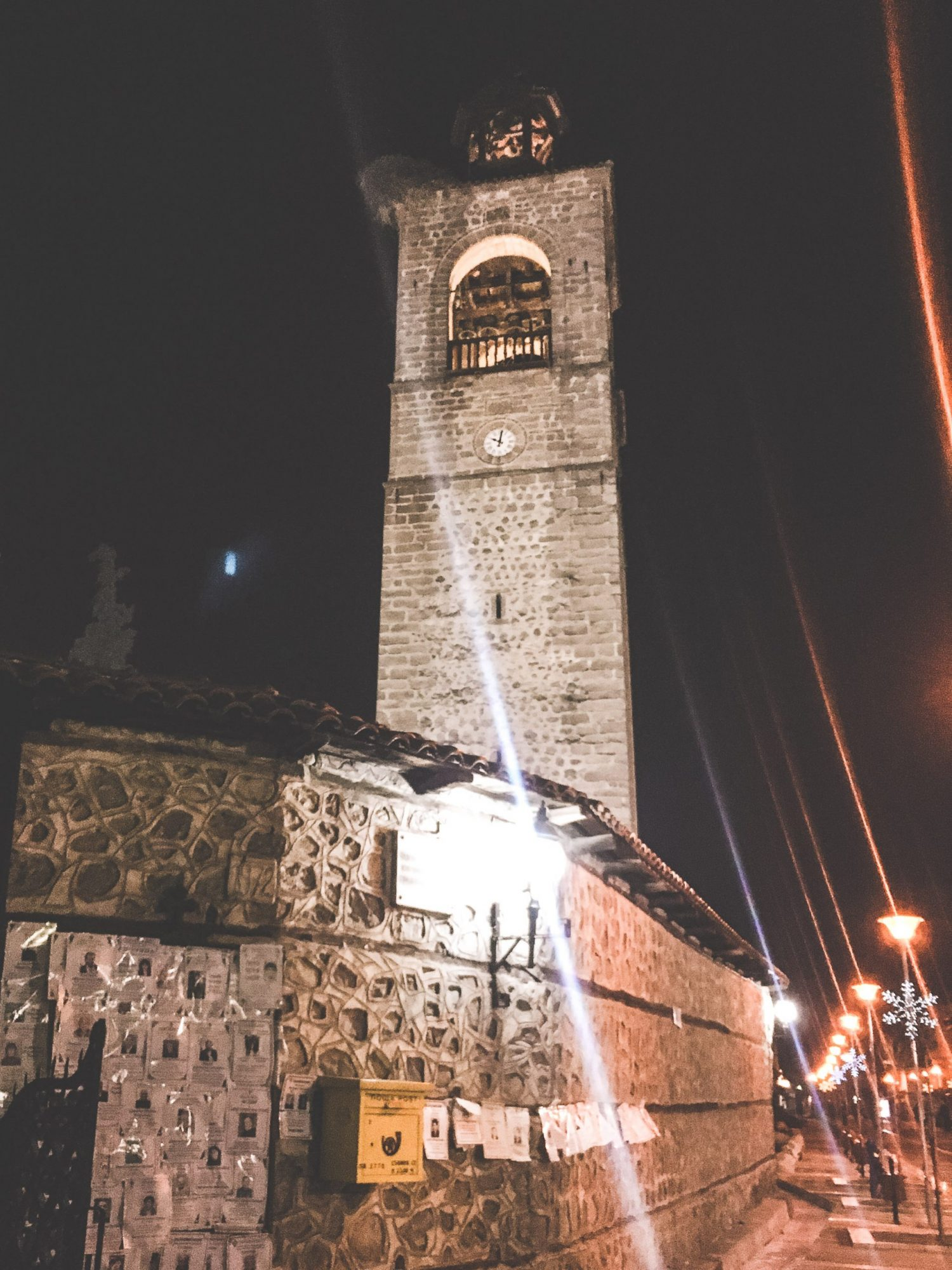 The Holy Trinity Church tower in Bansko, Bulgaria's Old Town at night.