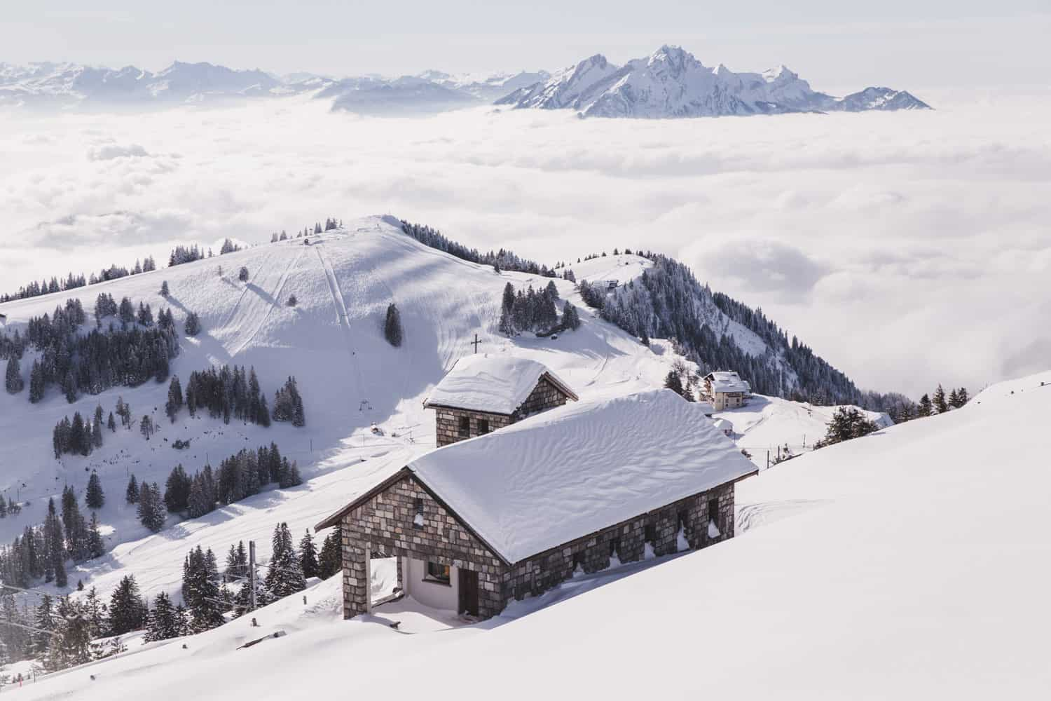 The view from Mount Rigi in Switzerland in the snow in winter. Rigi is a great destination to add to your travel list for 2020! Rigi in February.