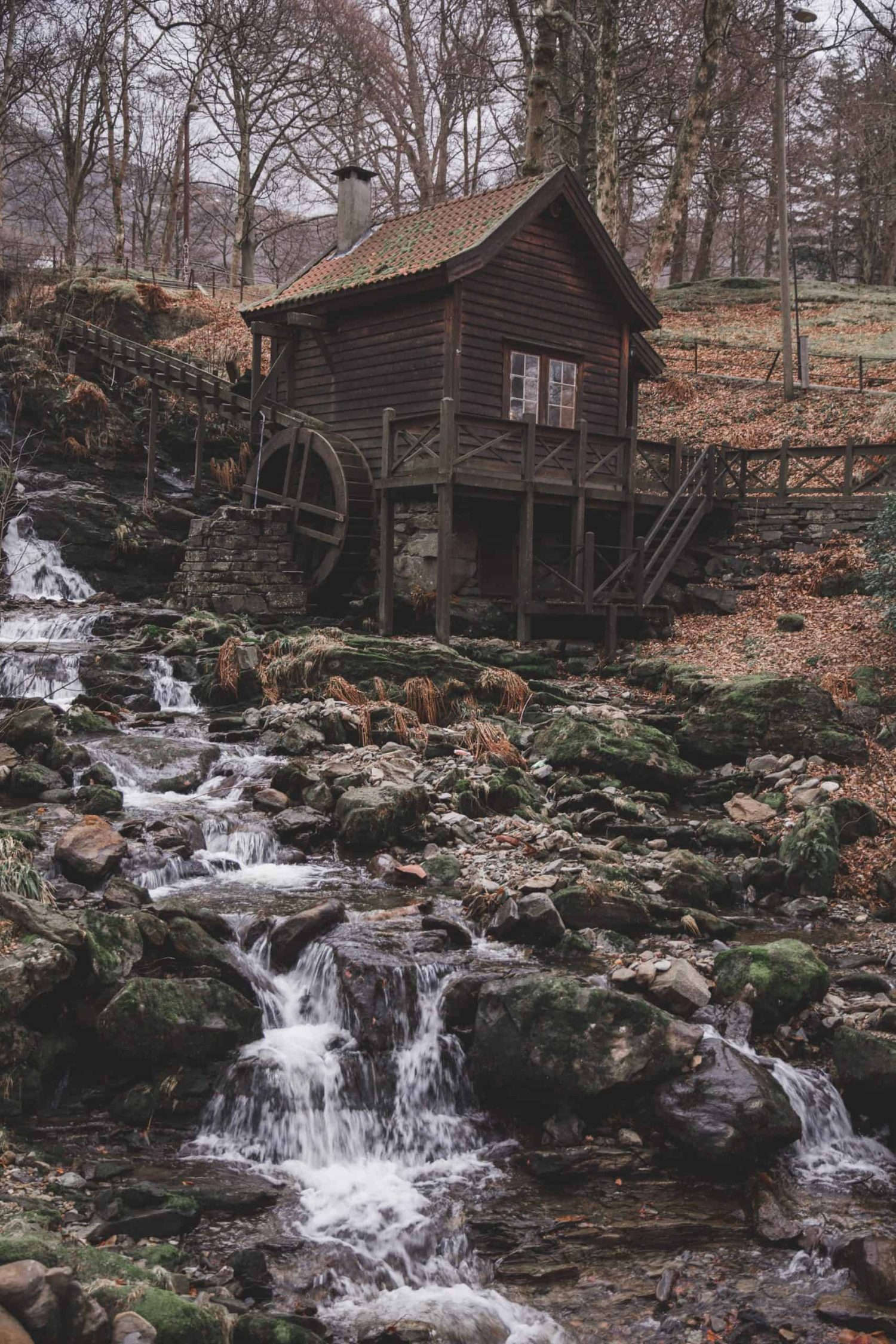 An old water mill next to a stream in Bergen, Norway.