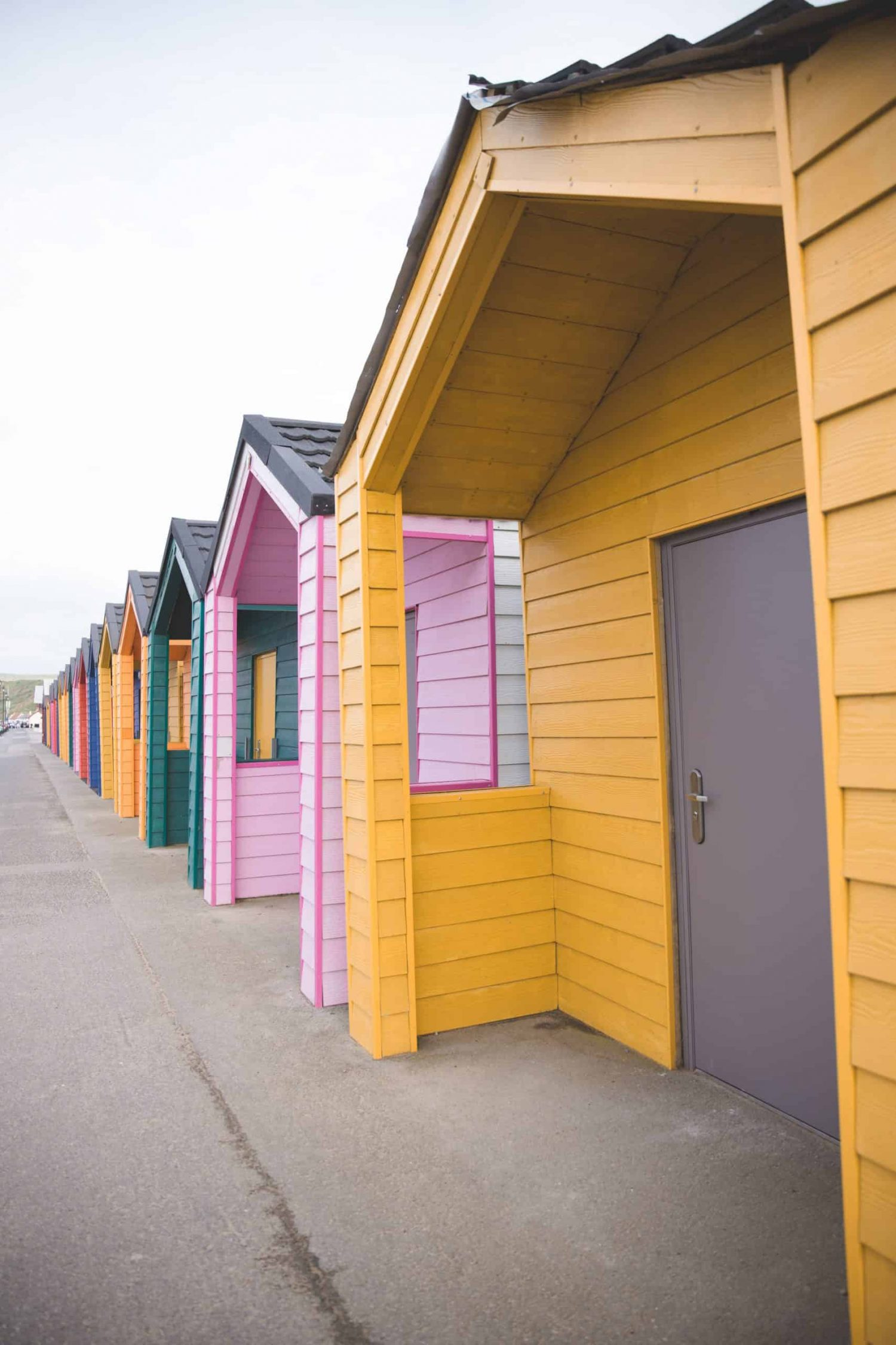 Colorful bright beach huts in Saltburn-by-the-Sea in England. The Yorkshire coast is one of my favorite places from 2019, and a great destination to travel to in 2020!