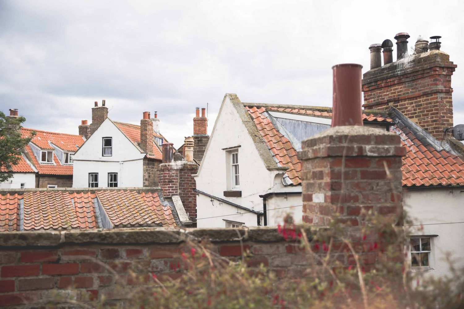 Red rooftops in Robin Hood's Bay in England. Robin Hood's Bay is a great destination to travel to in 2020!