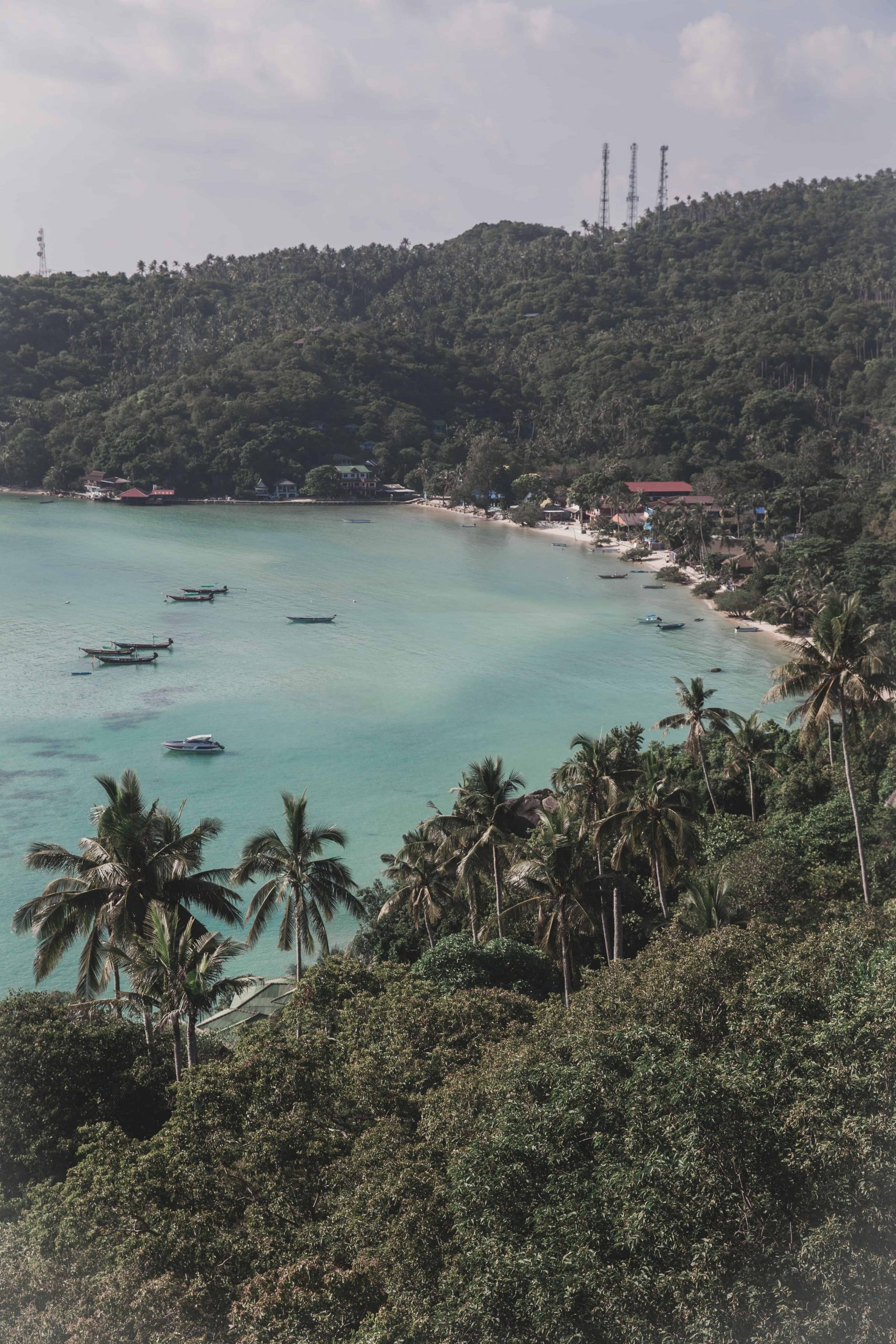 John Suwan Viewpoint in Koh Tao, Thailand has a view of blue water, beaches, and palm trees